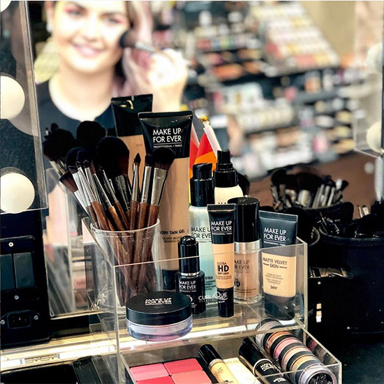 Assortment of Make Up for Ever Beauty Products and Makeup Brushes